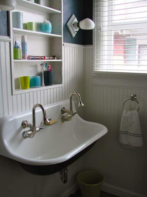 A wonderful vintage double sink!  I love these old sinks in kitchens too.  So much character.