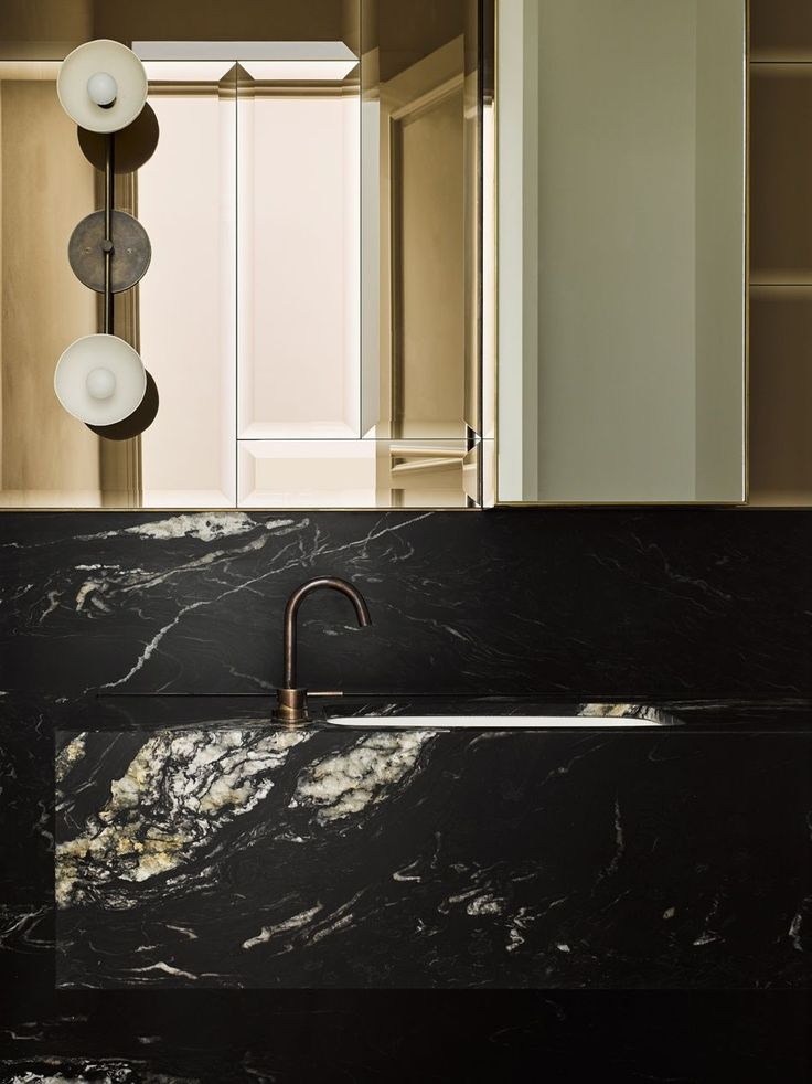 Masculine glamour in a bathroom by Flack Studio | Photo by Brooke Holm | Styling by Marsha Golmac