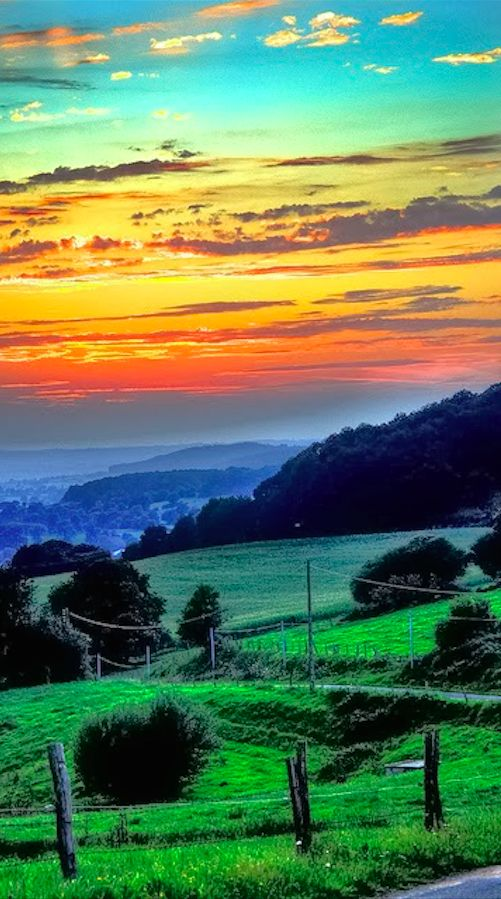 Sunset on the rolling hills of western Normandy, France • photo: Tony Shertila on Flickr