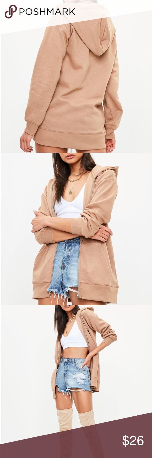 """NWT Missguided Camel Nude Tan Long Hoodie Brown S NWT Missguided Camel Tan Nude Hoodie Longline S Yeezy Kim Kardashian Earthtone Neutral  Brown longline hoodie with front pockets, long sleeves, ribbed hems and front zip fastening. Regular fit.   60% Polyester, 40% Cotton   Approx length: 70 cm/28"""" (based on a UK size S sample)  Brand new item. New with tags and plastic packaging.  Happy to bundle.   Smoke-free storage space. No flaws to note. Missguided Tops Sweatshirts & Hoodies"""