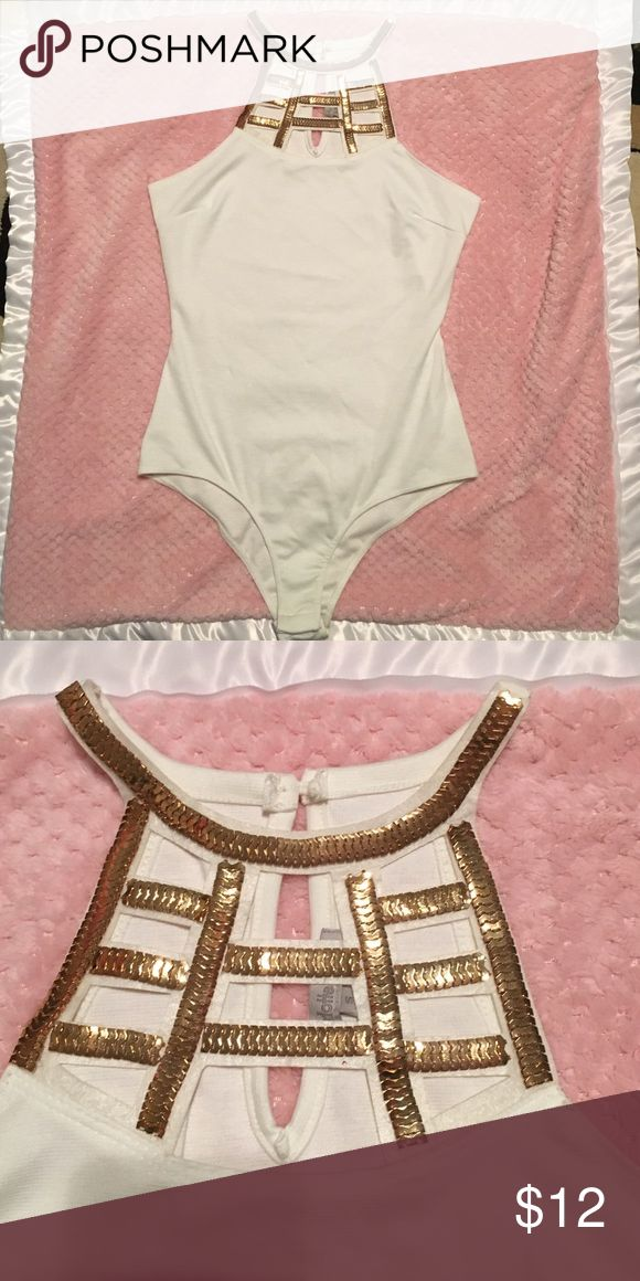 Cream one piece top with gold detail Charlotte Russe cream top with gold detail. Never worn. Great for going out Charlotte Russe Tops Tank Tops