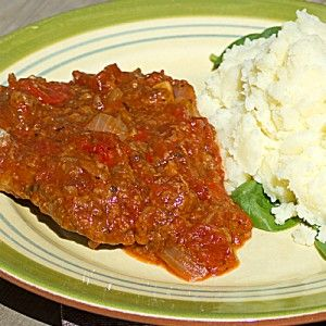 Swiss Steak.       2 pounds of steak (round, sirloin, cube, minute)      1 cup flour      1 tsp salt      1 tsp pepper      1 tsp paprika      ¼ cup olive oil      3 garlic cloves, minced      2 onions, sliced      2 peppers, diced      2 celery stalks, sliced      2 cans of diced tomatoes      ½ cup water      1 can tomato paste,   bake, covered in 325 oven for 2 hrs.