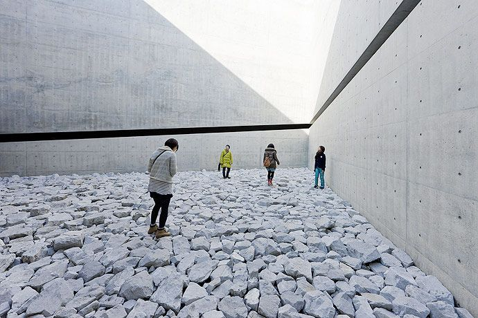 """all photos by iwan baan """"Chichu Art Museum, established in 2004, is itself a quintessential site-specific work of art. The museum invites us to rethink our relationship with nature, a central theme in the ideological landscape of Naoshima. Located on the south side of Naoshima, the Tadao And"""