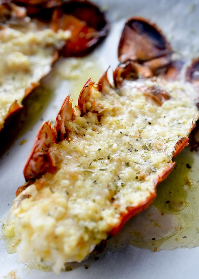 Baked Lobster Tails with Garlic Butter – Recipe Diaries    Ingredients:  4 lobster tails 5 cloves garlic, minced  ¼ c. grated Parmesan  Juice of 1 lemon  1 tsp Italian seasoning  4 tbsp melted butter  Preheat oven to 350 degrees F Combine ingredients, clean tails, brush on mix and bake 15min on baking tray.