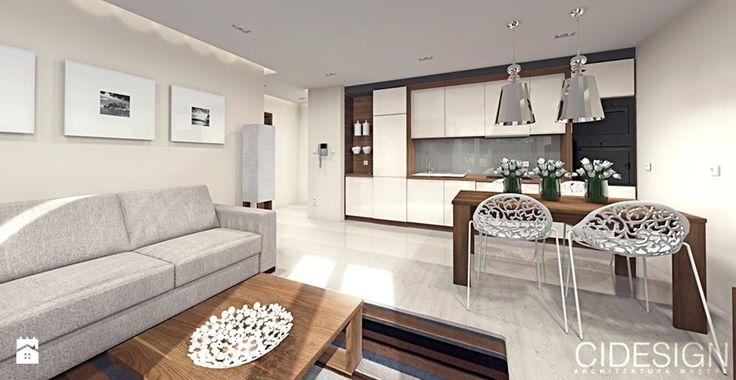 Salon z aneksem kuchennym i jadalnią krem i orzech. Salon - zdjęcie od Cidesign Architektura Wnętrz