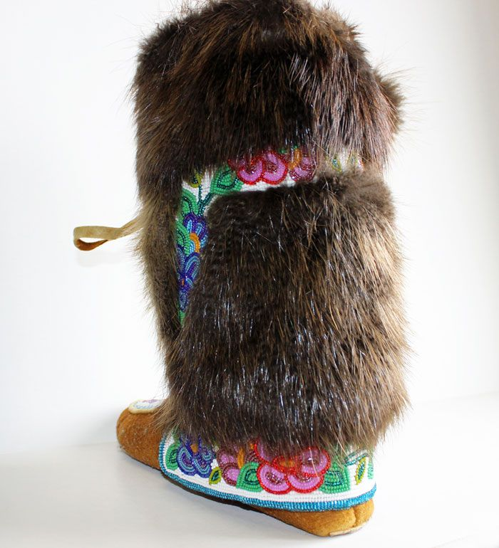 Sometimes Christmas comes early! Beautiful hand crafted authentic moose hide soles with beaver fur. Beautiful example of Dene Mukluks made in the north. The meticulous floral bead work all over the mukluks. Has a duffel lining. Size 8 women. $2000.
