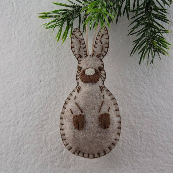 Stitch up an adorable little rabbit! Give the gift of handmade, or keep him for yourself :) He makes a great animal-themed nursery accent, year-round tree or wreath ornament and gift topper, too! This listing is for an Instant Download PDF sewing PATTERN for a Woodland Rabbit ornament.