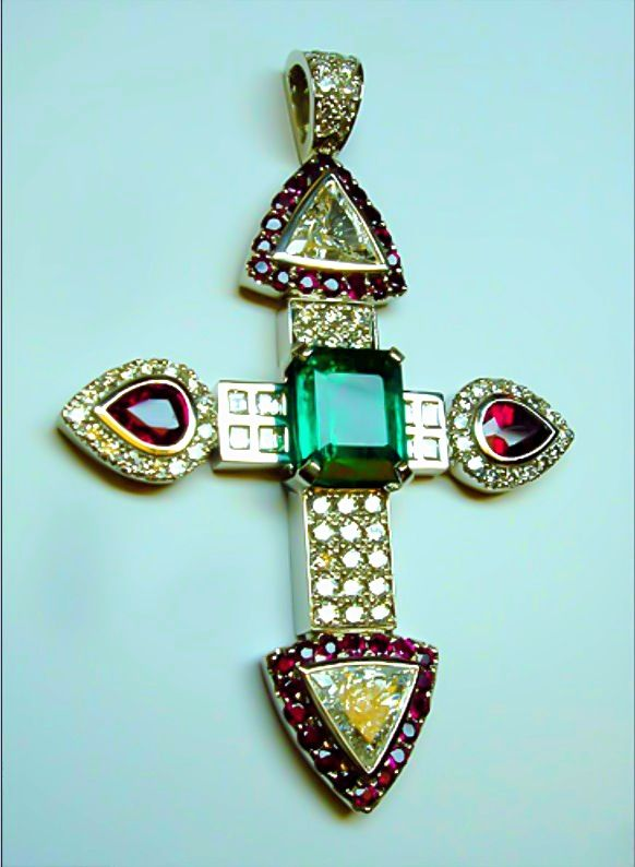 Fit for a Queen. Handmade by Link Wachler Designs. White gold cross re-designed from five different pieces of jewelry. Emerald, diamonds and rubies.