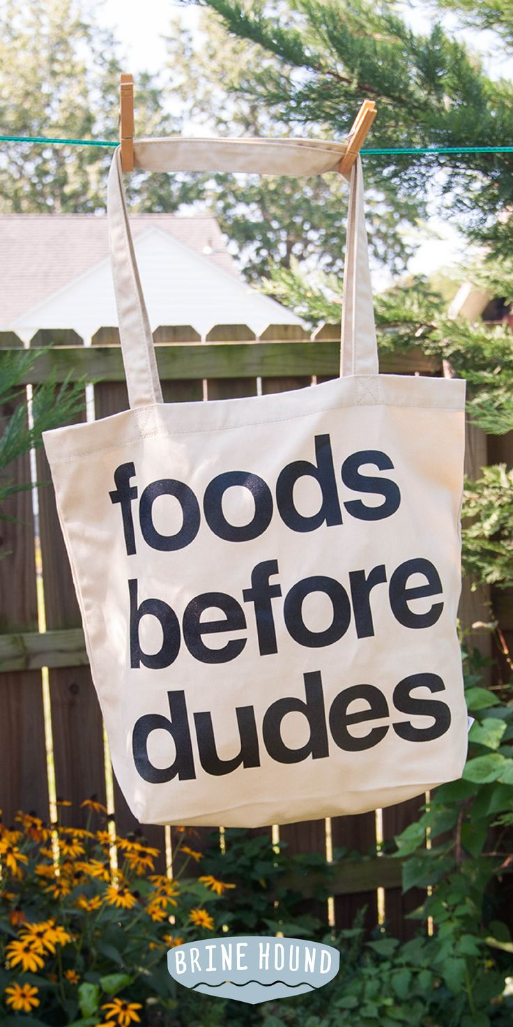 Foods Before Dudes is a modern proverb. Let everyone at the farmer's market and grocery store know exactly where your priorities lie with this statement American Apparel canvas tote bag.
