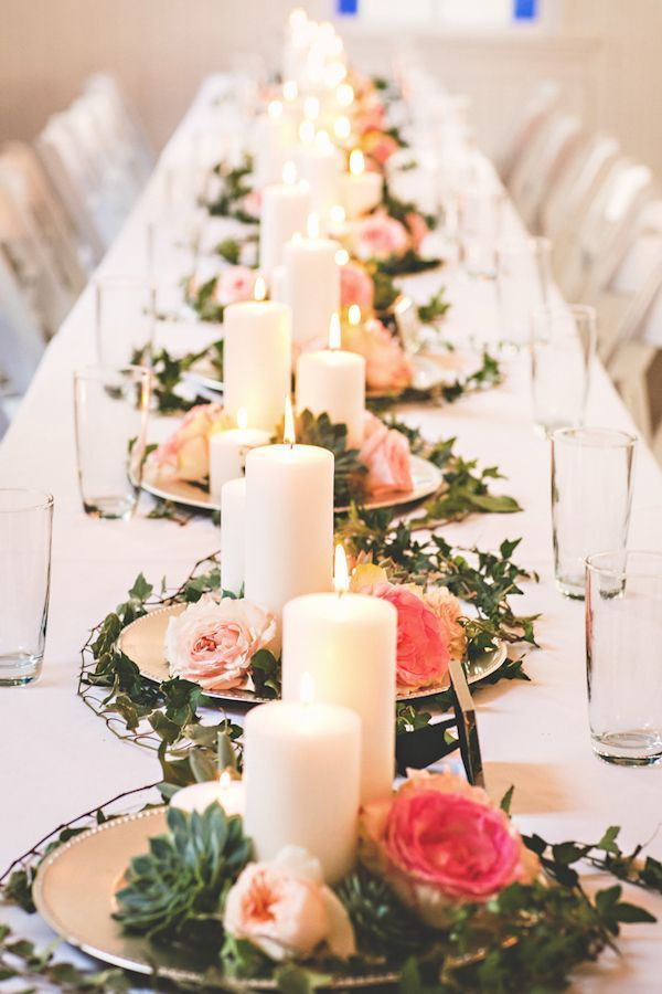 Love this tablescape! Beautiful centerpieces down the center of the table using small platters of flowers, greenery, and clusters of candles. So romantic and pretty! Love this!!