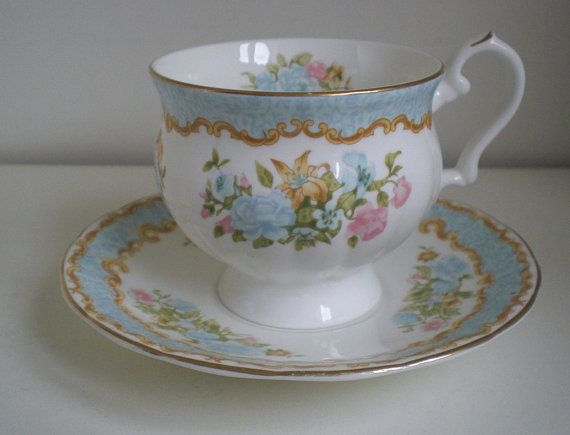 """Royal Canterbury""""Warwick"""",Tea Cup and Saucer,Floral Footed Cup,Made in England, Fine Bone China, Blue and Pink Roses, Gold Rim."""