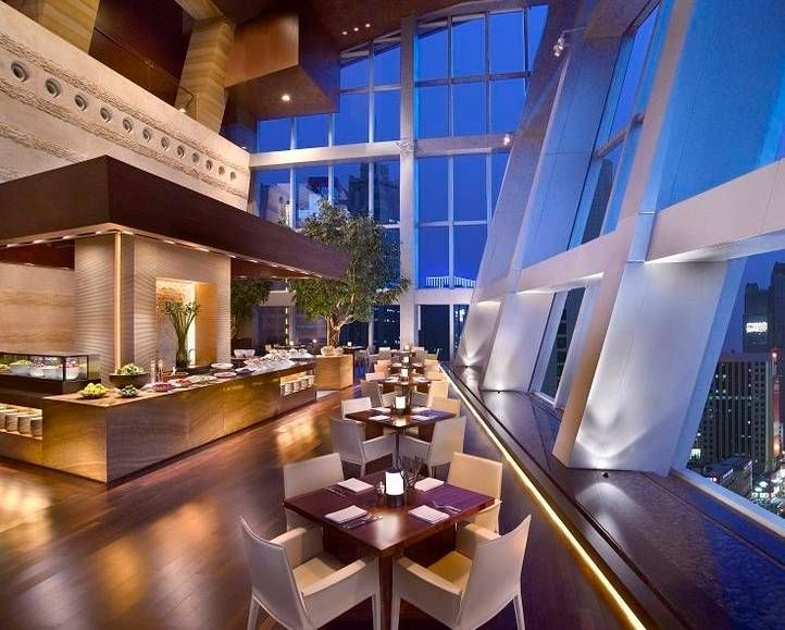Experience an evening of dining like no other within the lively setting of The Show Kitchen at Grand Hyatt Shenzhen China, a glass encased restaurant looking out over the city.