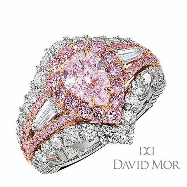 Rosamaria G Frangini | High Pink Jewellery | David Mor Jewellery A 1.88 carat pear shape fancy pink diamond center stone, featuring two taper diamonds, surrounded by fancy pink and white melee diamonds.