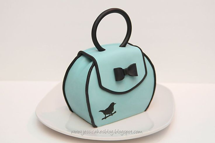 This is a tutorial for a small purse cake made from three 6″ round tiers. Each tier is about 3/4″ thick making the...