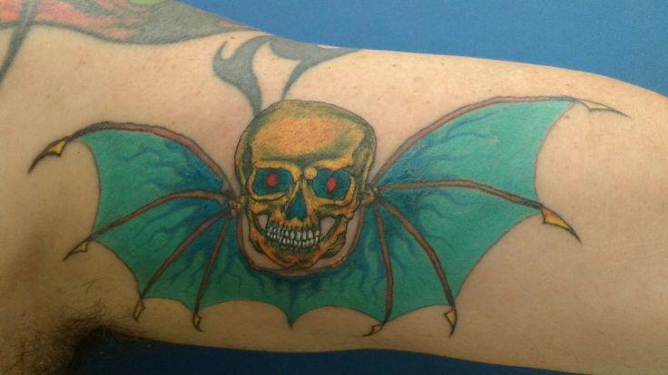 Tattoo caveira com asas