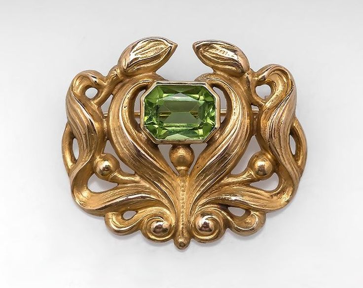 ART NOUVEAU ANTIQUE NATURAL PERIDOT GEMSTONE BROOCH PIN SOLID 14K YELLOW GOLD. This lovely Art Nouveau antique brooch is crafted of solid 14k yellow gold and features a natural peridot gemstone. This lovely pin is very ornate and in very good condition but the peridot does show some light abrasion.