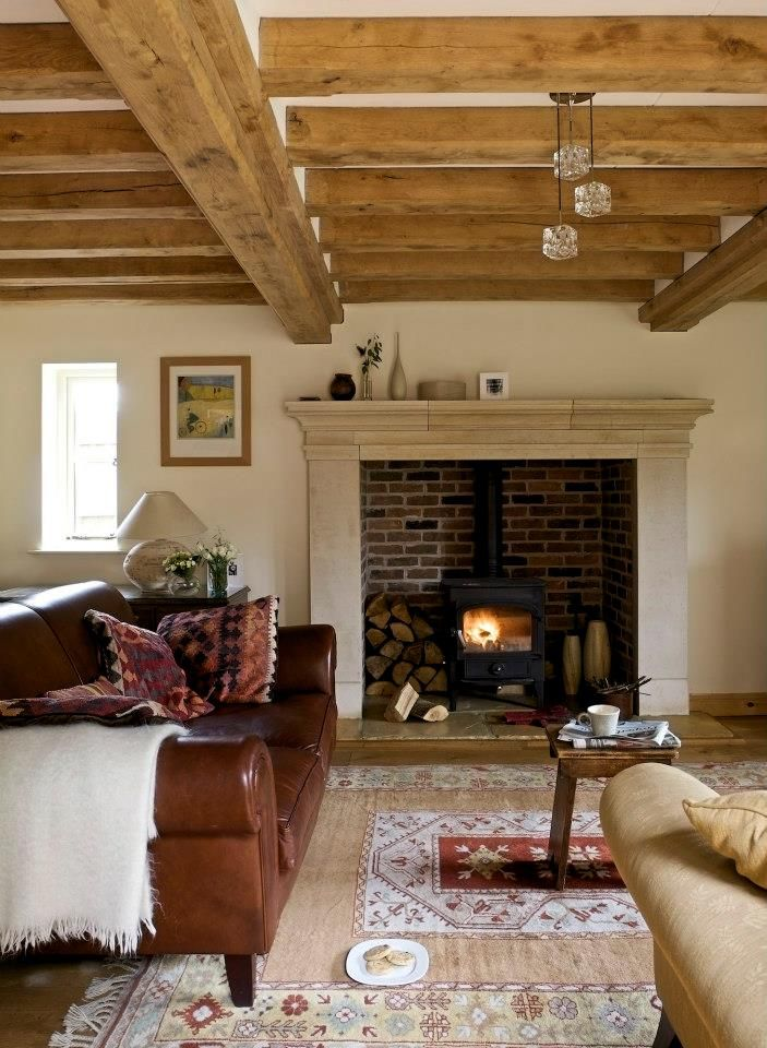 Breakfast room vibe: leather armchair, rugs, fire surround