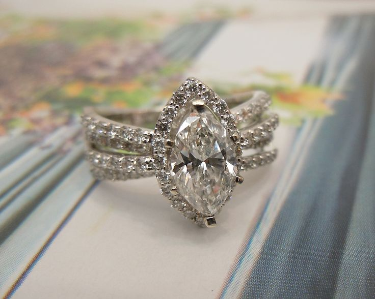 """A lot of people consider Marquise diamonds to be out dated. Here's a stunning setting to make that Marquise diamond look modern and magnificent! 14K White Gold, 1.10 ct Marquise Diamond Halo Engagement Ring """"Previously Enjoyed"""" Price: $6,998 A customer saw this setting and brought us her wedding ring to re-set. Needless to say, she is extremely excited by her new ring! . . . . . . . .... Read More »"""