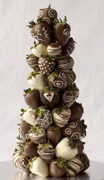Make your Valentine's Day display look as good as it tastes!  How cool is this chocolate covered strawberry tree?