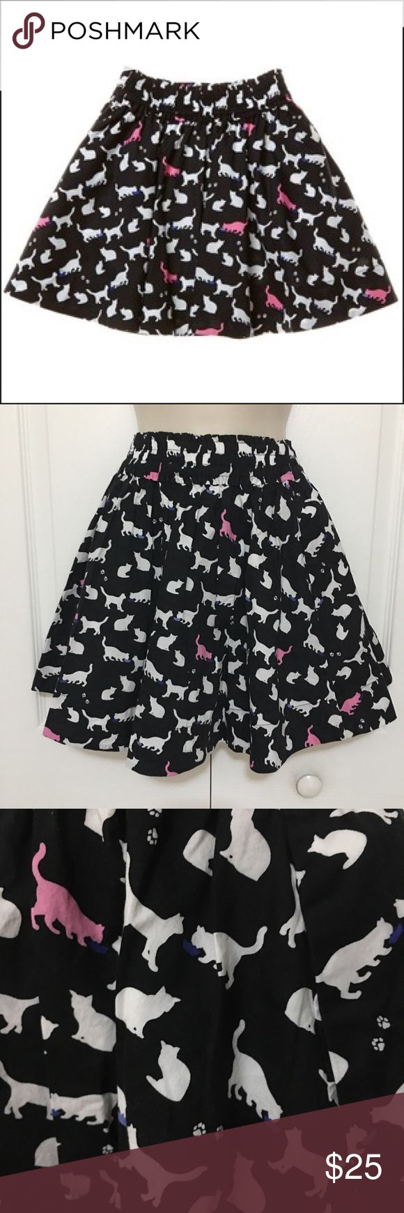 "💋Kate Spade girls' cat print skirt💋 Size Medium Made in China Made of 97% cotton, 3% elastane From the ""Skirt the Rules"" collection, Elastic band flare short skirt with cute cat print design in black, pink, purple and white.  Preowned and in excellent condition. Waist band: 11.5"" Length: 15.5"" kate spade Bottoms Skirts"
