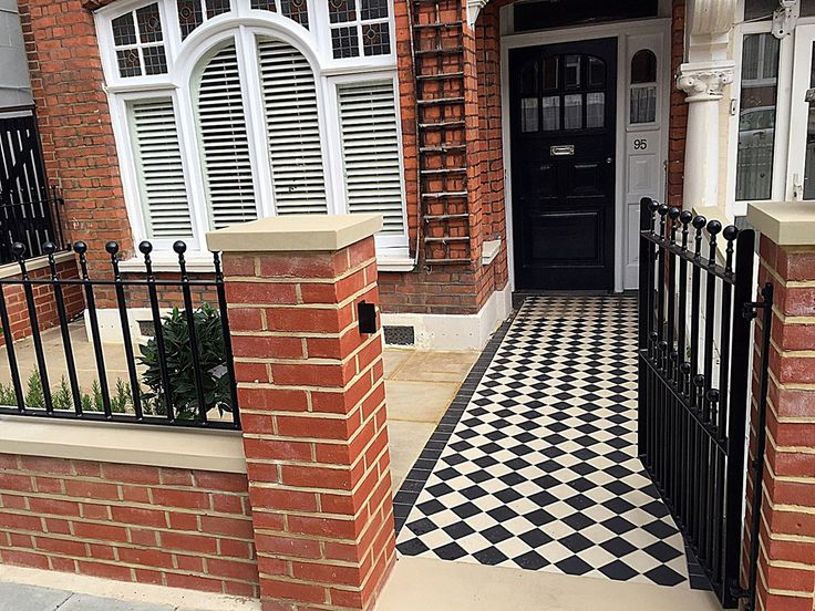 Victorian Classic Mosaic black and white red brick wall metal gate rails paving London Clapham Balham Wandsworth