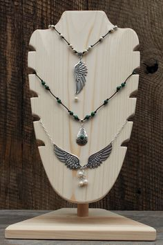 """Necklace display, 7"""" x 12"""" face overall is approximately 14""""."""