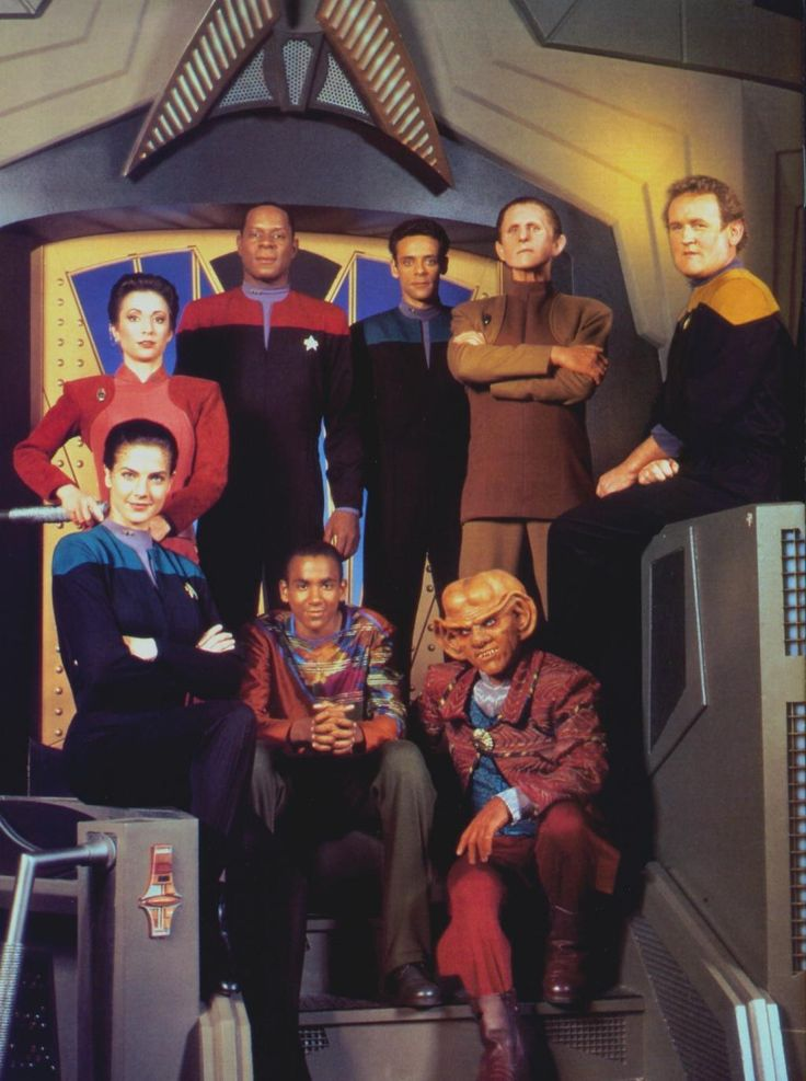 DS9 Crew ~ oh wow this is from before TNG ended. (You can tell because Avery Brooks has hair; the producers or whoever wouldn't let him shave his head because they didn't want to have two bald captains at once.)