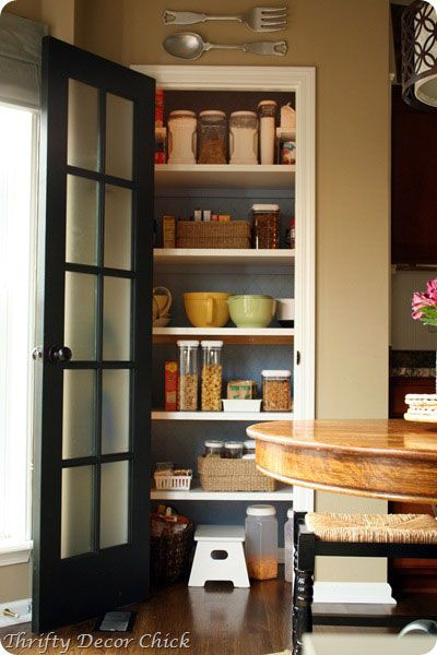 Another use for that repurposed French door (would make a plain pantry door so much prettier)