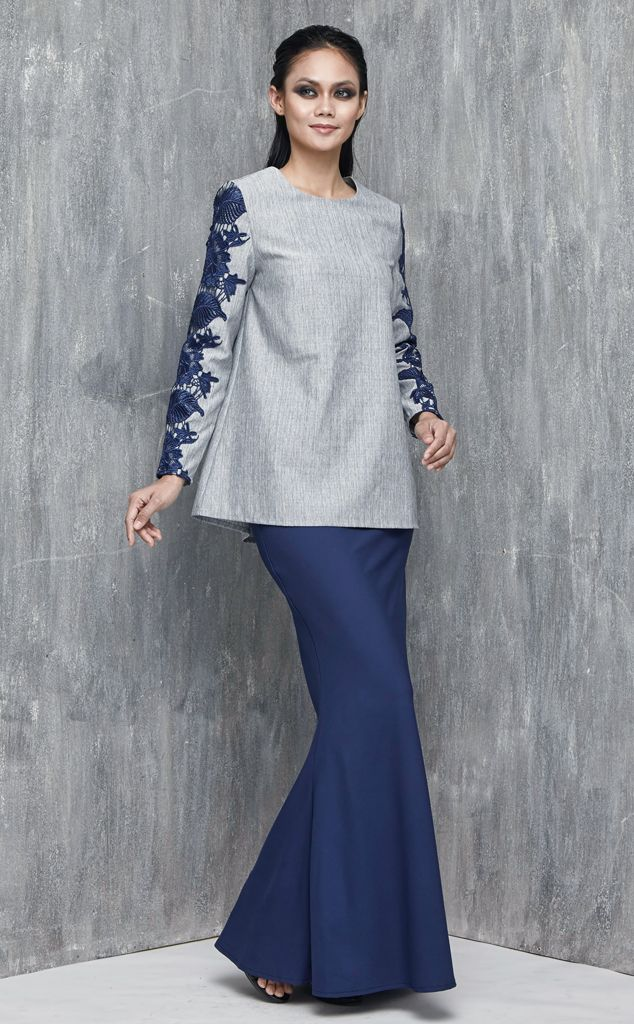 EMEL X DAPHNE IKING - LONGHORN - Modern A-line Baju Kurung with Lace (Blue) This A-line modern baju kurung is all about the class and simplicity with border lace on the sleeves. Also, the top is a tweed inspired fabric that's makes a lovely ensemble with the border lace. #emelxCLPTS #emelxDaphneIking #emelbymelindalooi #bajuraya #bajukurung #emel2016 #raya2016 #DaphneIking #lookbook #aline #lace #blue #moden #2016 #baju #kurung #baju #raya