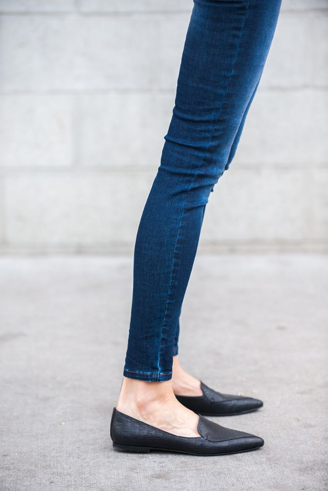 Skinny blue jeans and flat black loafers.