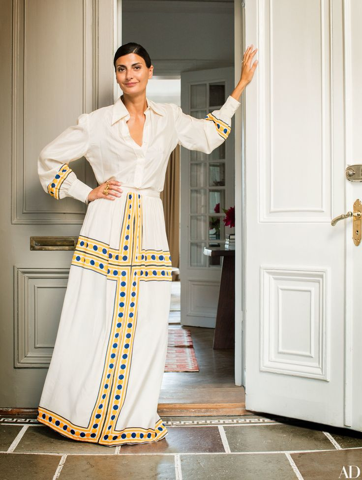 Fashion Editor Giovanna Battaglia stands in her Stockholm apartment wearing vintage Valentino | archdigest.com