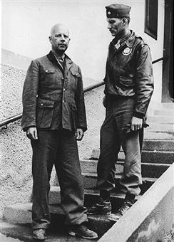 Former SS General Karl Oberg (1897-1965), disguised as an Austrian soldier, with Major Simmons who recognised him in Kitzbuhel, Austria, 24th February 1954. Oberg, known as 'The Butcher of Paris' was put on trial and sentenced to death but this was reduced to life and he was later pardoned in 1965. Pin by Paolo Marzioli