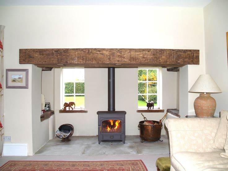 Renovated Essex inglenook with clad reclaimed oak beam, sand stone hearth and Clearview vision 500 wood burning stove installation in Fyfiel...