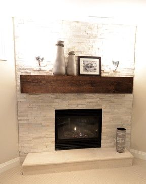 Visual interest is created with this fireplace by the smooth lines and dark  color of the mantel contrasting beautifully