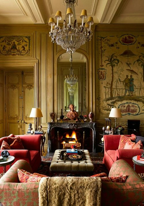 Love the tipsy yellow candle shades on the chandelier echoing the warmth of the Fireflame and walls.