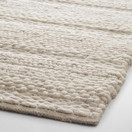 Our hand-woven wool area rug boasts a plush, incredibly chunky feel that captures the warm and inviting appeal of your favorite knit sweater. A variety of weaving patterns give this exclusive find a varied combination of textures.