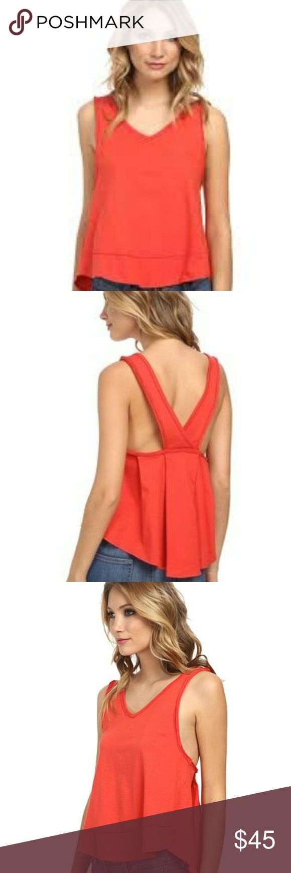We the Free Jersey Orange/Red Tank Top Super cute tank by Free People - We the Free! I love how this hangs low on the sides and the wide straps in the back, would look super cute if worn with a bandeau!   / 100% Cotton Free People Tops Tank Tops