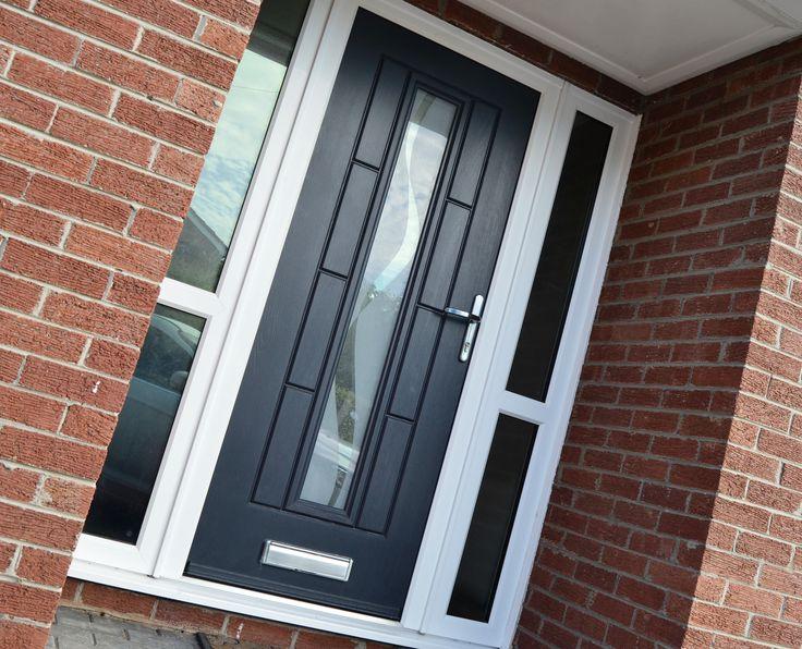 A Touch of Class: Onyx Black Vermont Rockdoor Ultimate with glass side panels. #Rockdoor #ContemporaryDoor #HomeImprovement