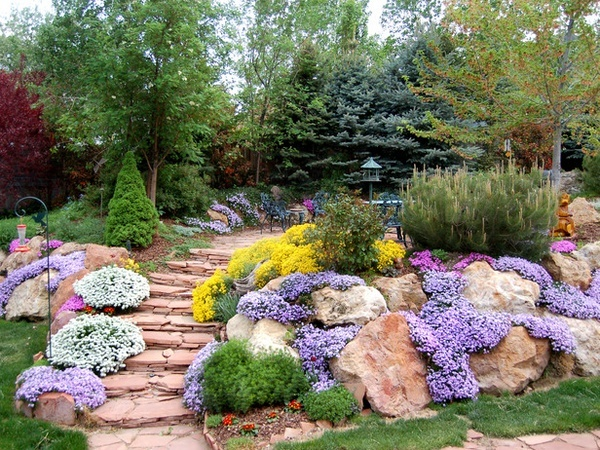 A Rock garden, a few big rocks, all the same kind or color, set at least halfway into the ground, so they look stable and like they've been there a while.  Planted with low growing mounding plants.