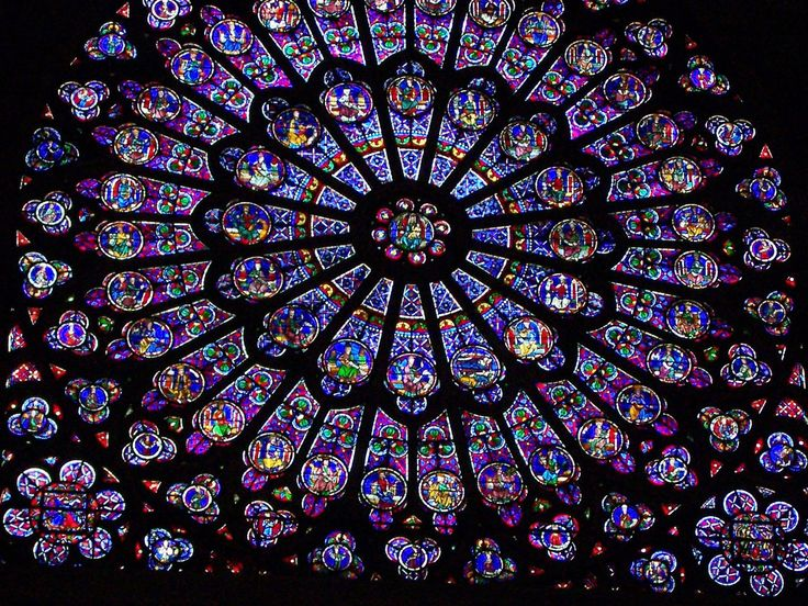 A stained glass window at Notre Dame Cathedral.  http://publicdomainpictures.net  FREE PUBLIC DOMAIN PHOTO'S TO USE AS YOU LIKE.