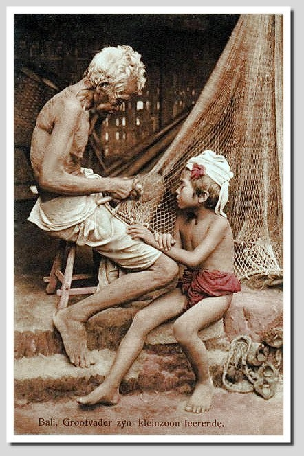 Early postcard from Bali, 1914. Mending fishing nets.