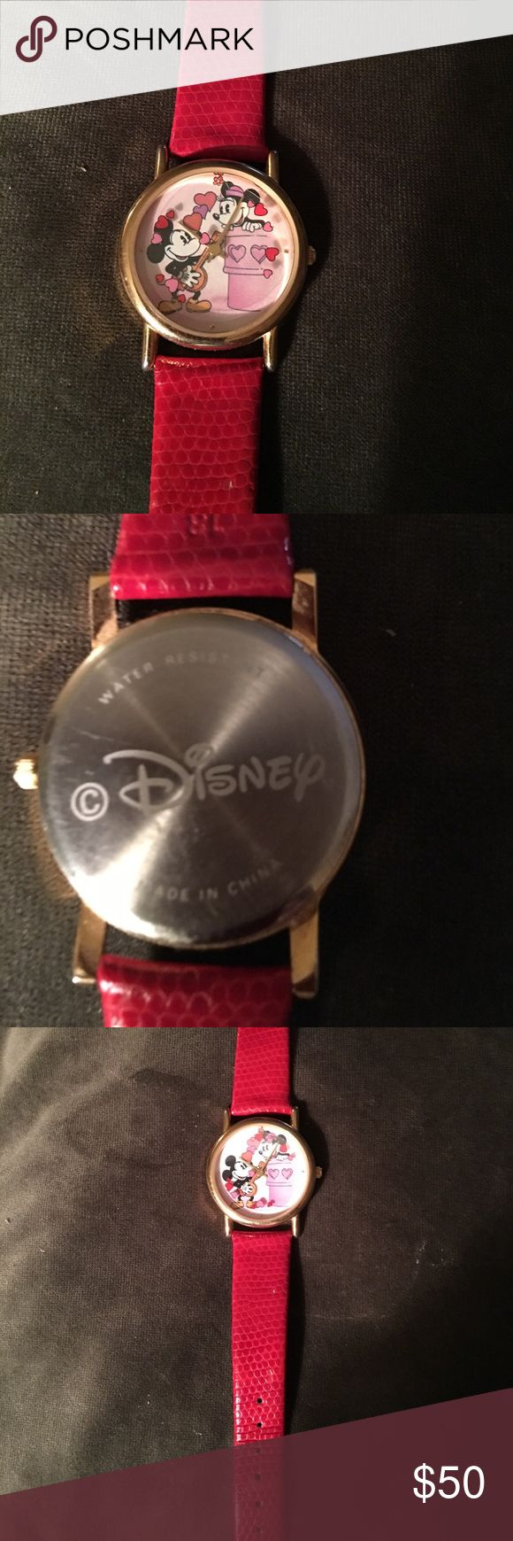 Disney Mickey & Minnie Quartz Watch This is a cute watch. The second hand is hearts that go around . Red leather band . Very unique watch Disney Accessories Watches