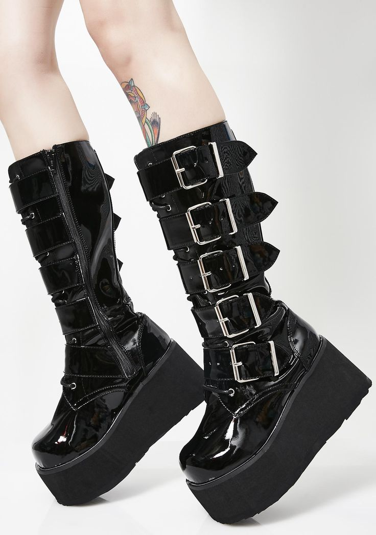 Demonia Trashville Knee High Boots has you dancin' in the darkness. Get higher in these sikk platform boots that have a lace-up front with five chunky buckle straps.