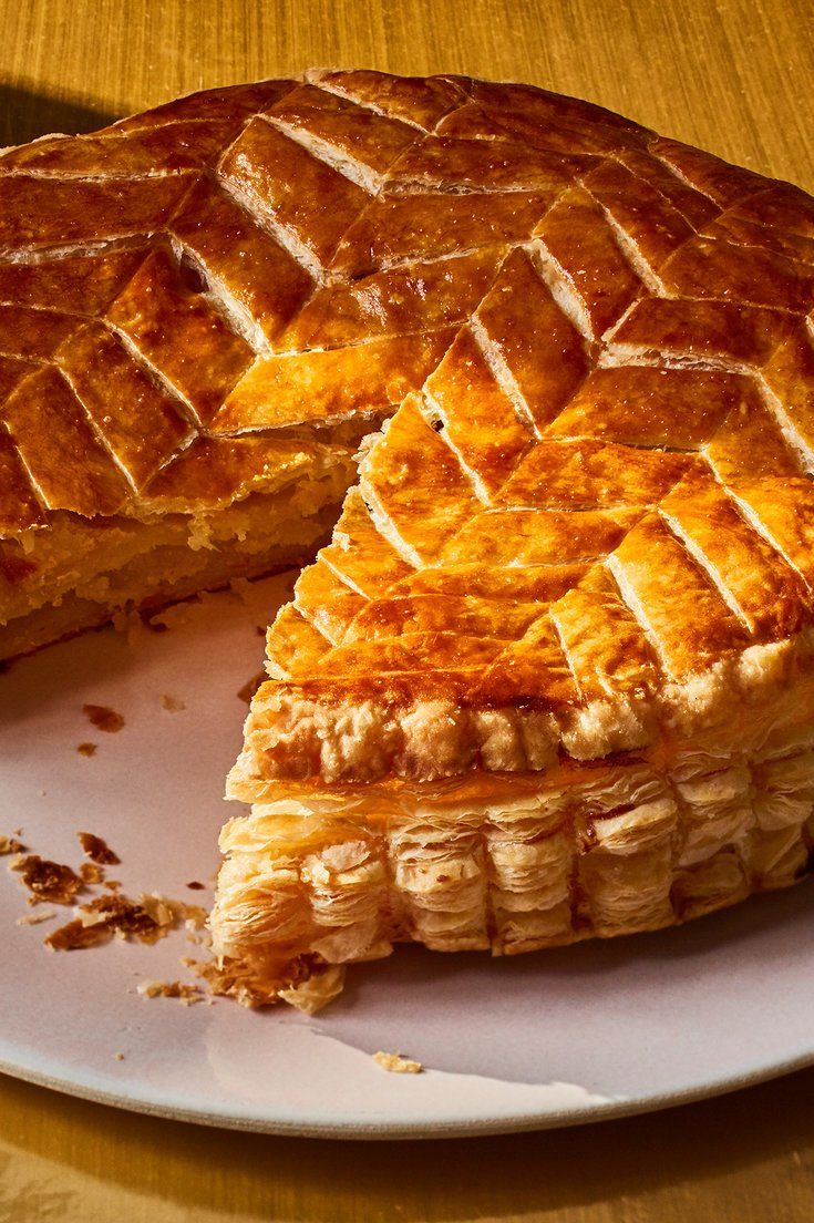 NYT Cooking: The galette des rois, celebrating Epiphany, the day the Three Kings (les rois) visited the infant Jesus, is baked throughout January in France. Composed of two circles of puff pastry sandwiching a frangipani filling, each comes with a crown and always has a trinket, called a fève, or bean, baked into it. It's an invitation to gather, as much party game as pastry – if your slice has the fève, yo...