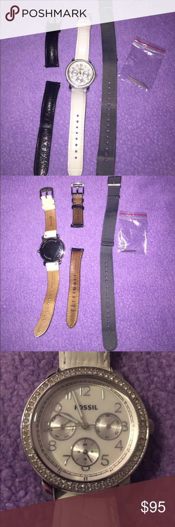 Fossil Watch Gemstone lined, with three interchangeable bands. One white genuine leather, one black genuine leather and one gray (I believe it's Nylon). No scratches on the face, minor scratches on the back. Brand new battery. Reads day of the week, date and time. Three of the gemstones appear yellowish, which you can see in the pictures, but I believe they could be cleaned. White band also has some minor imperfections as pictured, and the gray band has some signs of wear (color lighter on…