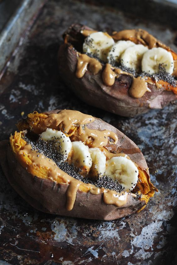 Check out this healthy vegan breakfast recipe with baked sweet potatoes stuffed with creamy almond butter, banana slices, chia seeds & a sprinkle of cinnamon! Source: www.ambitiouskitchen.com