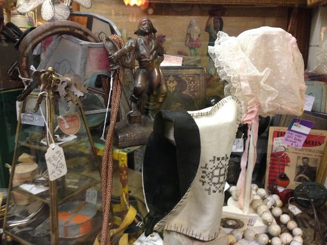 Vintage Baby Bonnets inside the Glass Case at Treasures N Junk, Ontario California