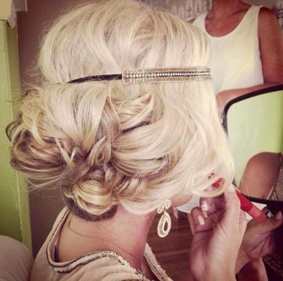 Big loose bun with headband around forehead for a 20's themed up-do