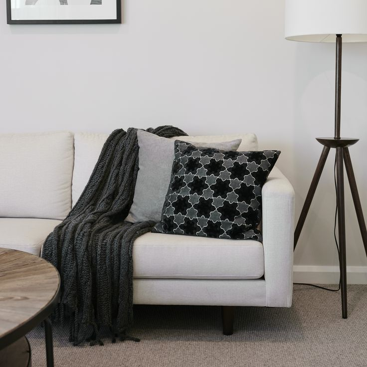 #monochrome #black #white #grey #lounge #couch #natural #timber #wood #cushions #throw #rug #relax