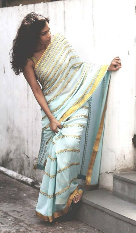 Sky blue saree with gold border and gold stripes on saree by Priyal Prakash